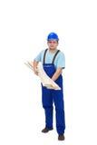Trabajador de construcción que lleva plancks de madera Fotos de archivo libres de regalías