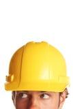 Trabajador de construcción que parece preocupado imagen de archivo