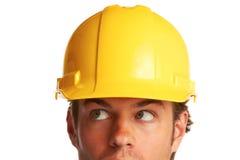 Trabajador de construcción que parece preocupado fotos de archivo