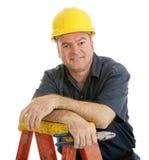 Trabajador de construcción relajado foto de archivo