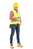 Trabajador de construcción Sending un mensaje de texto Fotos de archivo libres de regalías