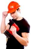 Trabajador de construcción sonriente con el taladro fotos de archivo