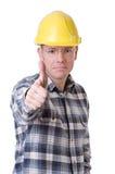 Trabajador de construcción con los pulgares para arriba Imagen de archivo libre de regalías