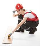 Trabajador de construcción en uniforme con el laminado Fotografía de archivo