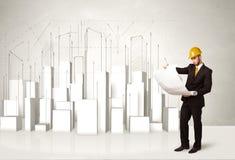 Trabajador de construcción que acepilla con los edificios 3d en fondo Imagenes de archivo