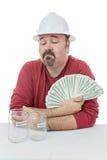 Trabajador de construcción que decide sobre el dinero Imagen de archivo libre de regalías