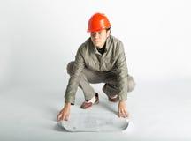 Trabajador de construcción y modelos masculinos el bosquejar Imágenes de archivo libres de regalías