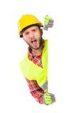 Trabajador de grito detrás del cartel blanco grande Imagen de archivo libre de regalías