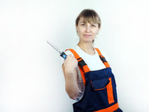 Trabajador de la muchacha con la herramienta Foto de archivo libre de regalías