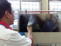 Trabajador de la pintura y de la capa Imagen de archivo libre de regalías