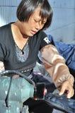 Trabajador de mujer en China Imágenes de archivo libres de regalías