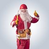 Trabajador de Santa Claus en casco con el martillo Fotos de archivo libres de regalías