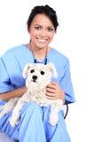 Trabajador de sexo femenino del cuidado médico con el perro imágenes de archivo libres de regalías