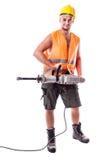 Trabajador del camino que sostiene un martillo perforador Imágenes de archivo libres de regalías