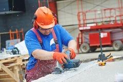 Trabajador del constructor en el emplazamiento de la obra Fotos de archivo