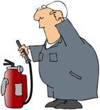 Trabajador desconcertado con un extintor Foto de archivo libre de regalías