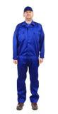 Trabajador en workwear azul. Foto de archivo