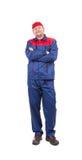 Trabajador en workwear rojo-azul Foto de archivo