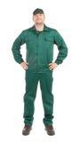 Trabajador en workwear verde. Imagenes de archivo