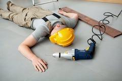Trabajador herido en el trabajo Imagenes de archivo