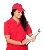 Trabajador joven con el uniforme rojo Imagen de archivo