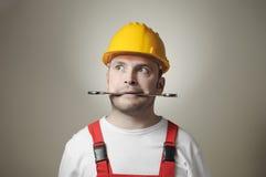 Trabajador joven loco Imagen de archivo libre de regalías