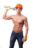 Trabajador joven muscular Foto de archivo libre de regalías