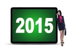Trabajador joven y números 2015 Fotos de archivo