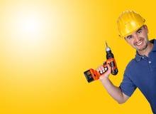 Trabajador manual caucásico joven con el taladro Imagen de archivo libre de regalías