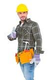 Trabajador manual confiado que gesticula el pulgar para arriba Fotos de archivo