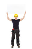 Trabajador manual que lleva a cabo el abover de la bandera su cabeza Foto de archivo libre de regalías