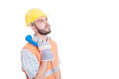 Trabajador o constructor de construcción que sostiene el teléfono Imagen de archivo