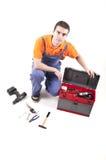 Trabajador y caja de herramientas abierta Fotografía de archivo