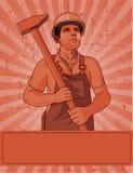 Trabajador y un martillo Imagenes de archivo