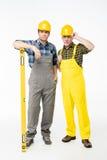 Trabajadores con la herramienta llana Foto de archivo libre de regalías