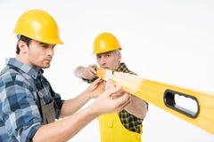 Trabajadores con la herramienta llana Fotos de archivo