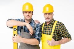 Trabajadores con la herramienta llana Fotografía de archivo
