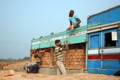 Trabajadores de campo de ladrillo Imagen de archivo libre de regalías
