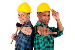 Trabajadores de construcción atractivos Imagen de archivo