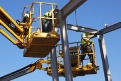 Trabajadores de construcción de acero foto de archivo