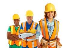 Trabajadores de construcción felices foto de archivo