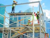 Trabajadores de construcción, Singapur Imágenes de archivo libres de regalías