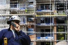 Trabajadores de construcción y sector de la construcción Fotos de archivo libres de regalías