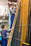 Trabajadores de la producción con diverso PVC Imágenes de archivo libres de regalías