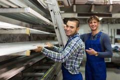Trabajadores de la producción con diverso PVC Imagen de archivo