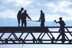 Trabajadores de la silueta Imagen de archivo libre de regalías
