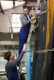 Trabajadores de producción con diverso PVC Foto de archivo libre de regalías
