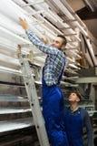Trabajadores de producción con diverso PVC Fotos de archivo libres de regalías
