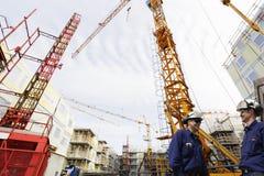 Trabajadores del sector de la construcción y del sitio fotografía de archivo libre de regalías