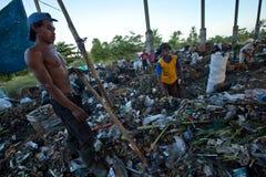 Trabajadores en un barrido en el vaciado Imagen de archivo